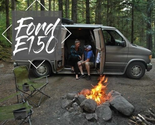Ford-e150-camping-van-roadtrip-camper-campfire-mountains-wood