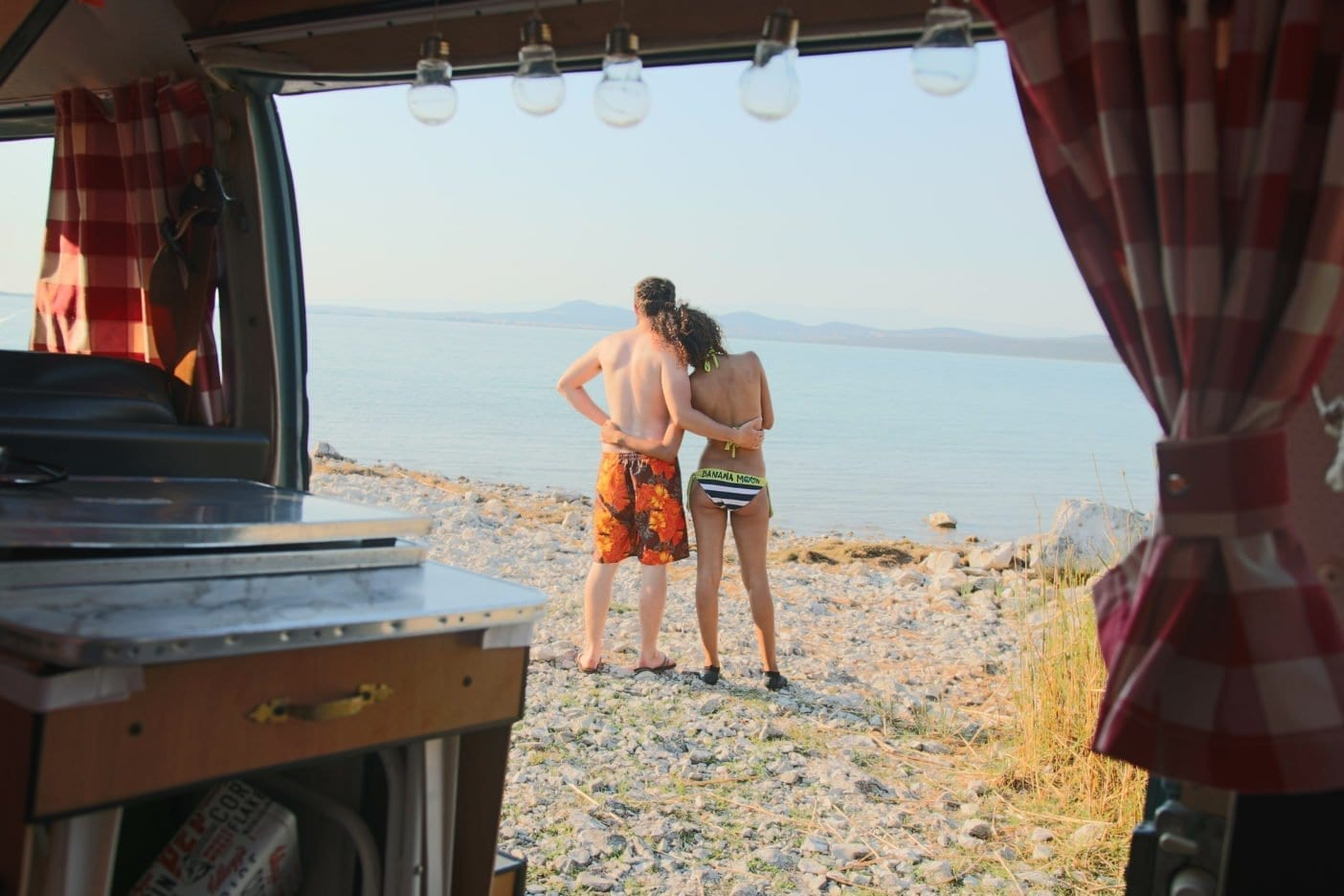 Vw-T2-Bulli-VW-Camper-Van-Campervan-camping-interior-couple-beach-bikini